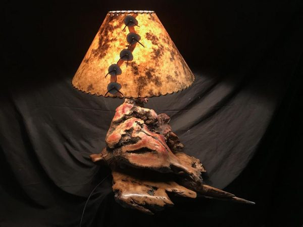 This beautiful manzanita burl lamp. It has turquoise inlay through out and is finished with a custom made martyred wood base and rustic lamp shade - The Antler Shack Wood Wine Racks Wood Lamps